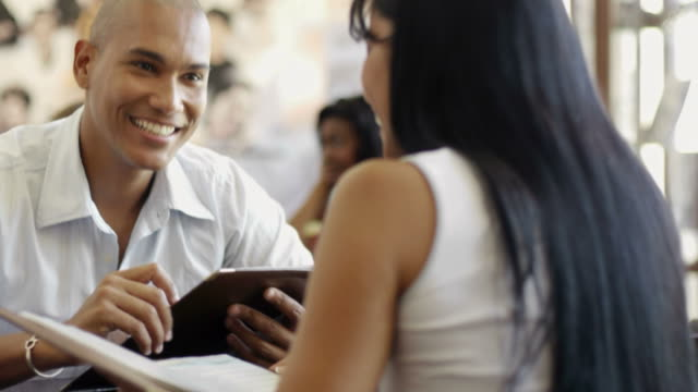 Man and woman dining out in restaurant video