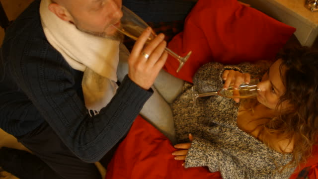 Man and woman drinking champagne in the new year video