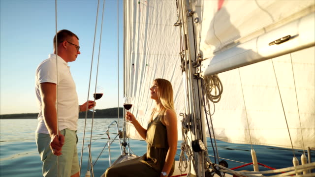 Man and woman drinking wine during romantic date on the yacht video