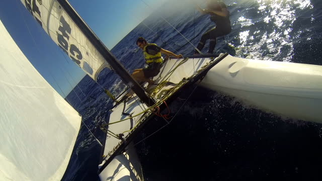 Man and woman enjoying extreme rest, sailing boat in open sea, summer vacation Man and woman enjoying extreme rest, sailing boat in open sea, summer vacation rivalry stock videos & royalty-free footage