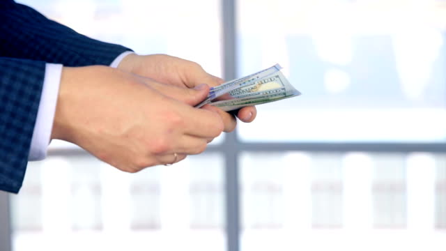 Man and woman hands in office transferring money video