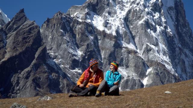 man and woman in the mountains - attività equestre ricreativa video stock e b–roll