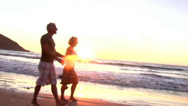 Man and woman kiss at sunset in slow motion video