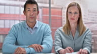 istock LD Man and woman making a video call from their office 597286536