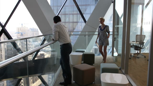 man and woman overlooking skyscrapers - heterosexual couple stock videos and b-roll footage