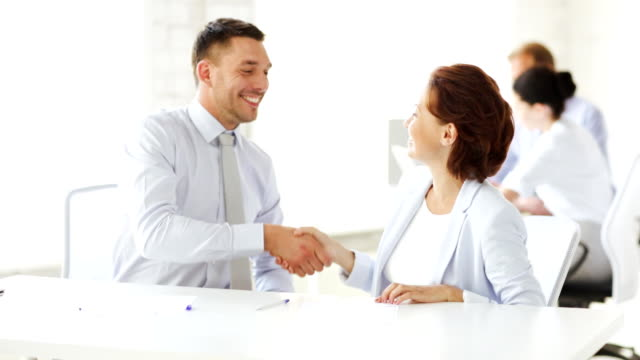 man and woman signing a contract business and office - man and woman signing a contract form filling stock videos & royalty-free footage