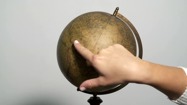 Man and woman spinning a globe video