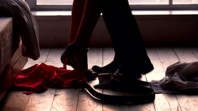 Man and woman undressing. Man and woman undressing. Clothes of couple, bedroom floor. human relationship stock videos & royalty-free footage