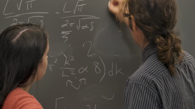Man and woman working and collaborating together on a complicate problem