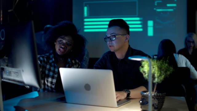 Man and woman working at laptop video