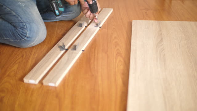 Man assembling Furniture with using tools at home Man assembling Furniture with using tools at home bolt fastener stock videos & royalty-free footage