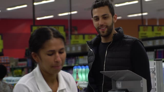 Man at checkout on the supermarket video