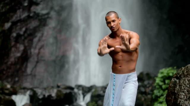 Man at waterfall video