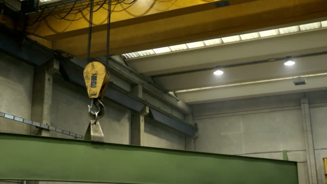 Man at work as welder in heavy industry facility video