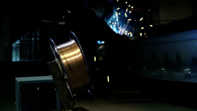 Man at work as welder in heavy industry video