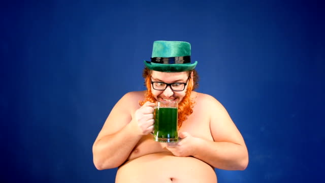 Man, beer and St. Patrick's Day. Funny man. shamrock stock videos & royalty-free footage