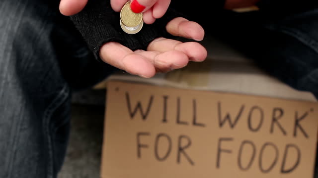 Man begging for change with outstretched hand, homeless sitting in the street video