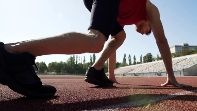 Man beginning his race with low start and running to meet victory, goal of life video