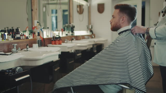 Man being prepared for haircut video