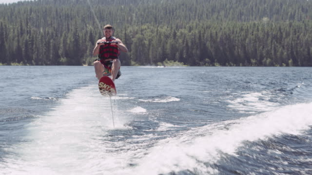 4K UHD: Man being pulled on hydrofoil by a boat video