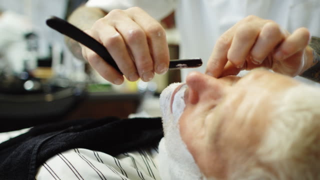 Man Being Shaved with Straight Razor video