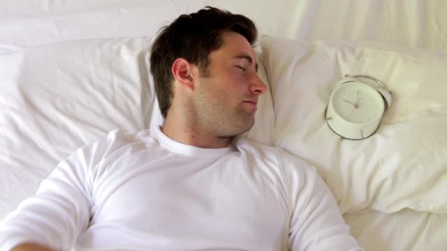 Man Being Woken In Bed By Alarm Clock video