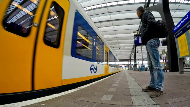 Man Beside High Speed Train at Rotterdam Central Station video