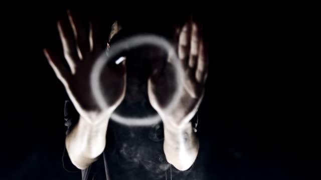 slo-mo-mann bläst rauch-ringe in die kamera - stunt stock-videos und b-roll-filmmaterial