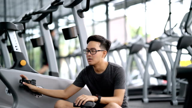 Man bored to do exercise workout in gym