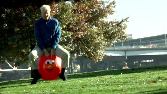 Man Bounces Through Park video