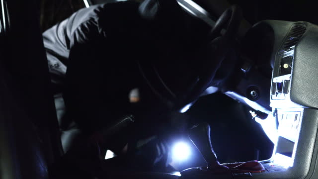 Man breaking into a car in the middle of the night video