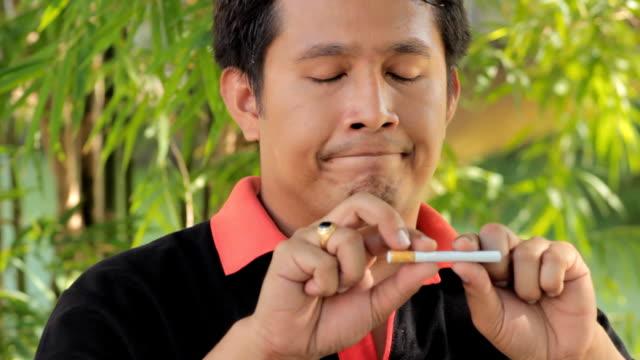 Man breaks a cigarette. video