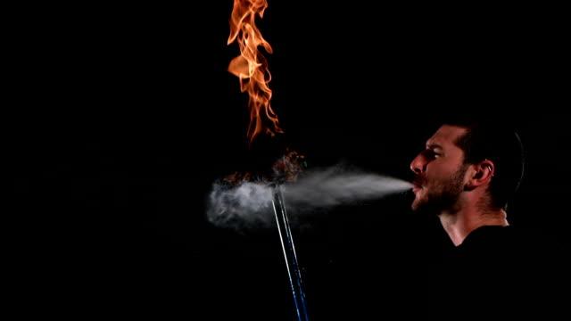 Man breathing fire, slow motion video