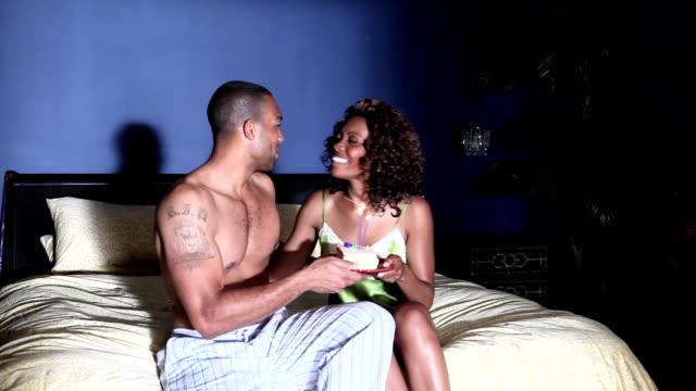 Man bringing cake to girlfriend Man bringing birthday cake to girlfriend in bedroom 20 29 years stock videos & royalty-free footage
