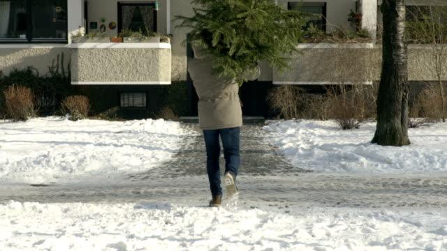 Man brings Christmas Tree home video