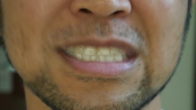 Man brushing his teeth video