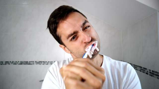 Man brushing teeth in the morning. video