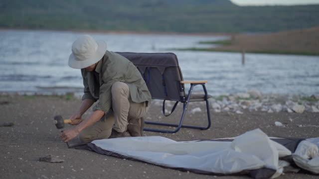 Man Building camping at Camping area video