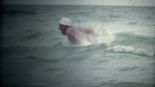 (Super 8 Vintage) Man Butterfly Swimming Open Water video