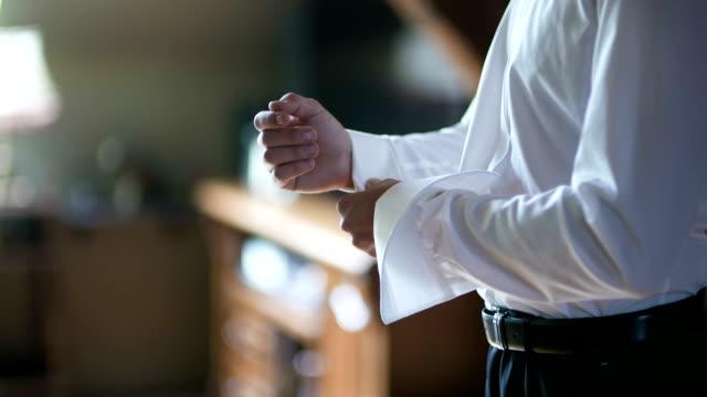 Man buttoning shirt closeup. Dressed man. Dressing up men's. Men hands. video