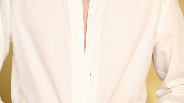 HD: Man Buttons Up the Shirt video