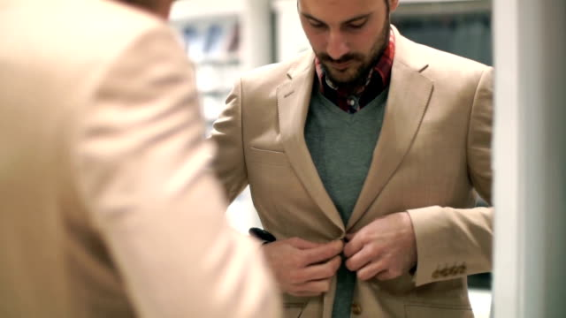 Man buying clothes at retail store. video