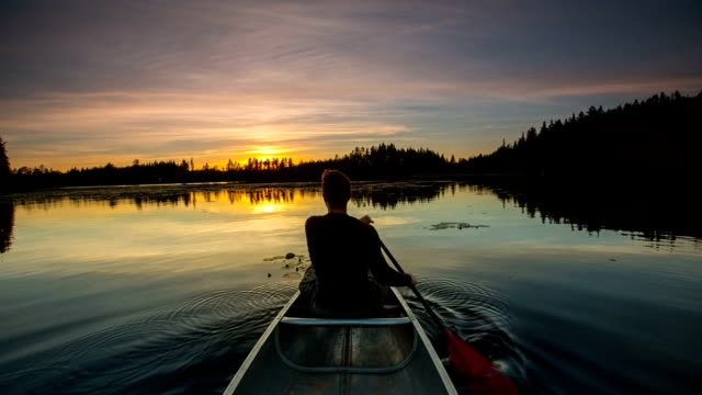 Man canoeing at sunset video
