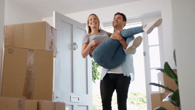 Man Carrying Woman Over Threshold Of New Home As Couple Move In Together video