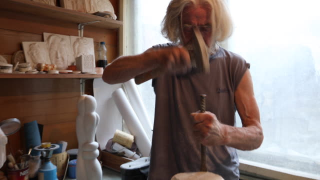 Man carving the marble