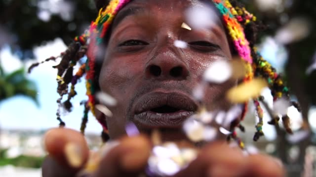 Man Celebrating Life With Confetti Party time caribbean stock videos & royalty-free footage