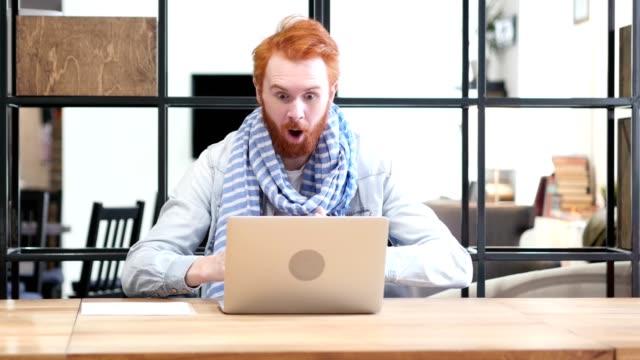 Man Celebrating Success while Working on Laptop video