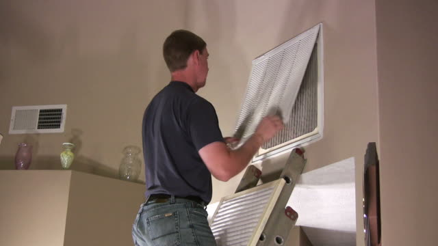 Man changes air filter in house video