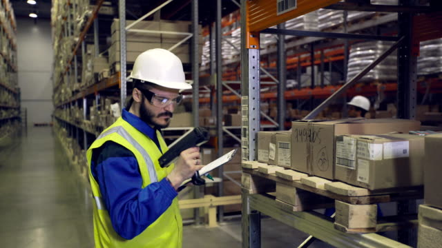 Man checking cargo on shelves with scanner video