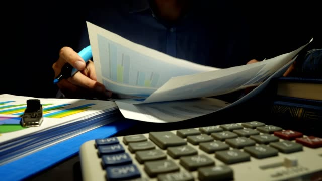 Man checking financial report or business documents. Auditor at the work. Man checking financial report or business documents. Auditor at the work. handbook stock videos & royalty-free footage